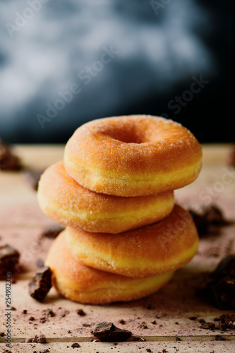 Photo stack of sugar glazed donuts.