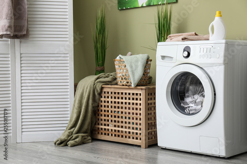 Fotografie, Obraz Interior of home laundry room with modern washing machine