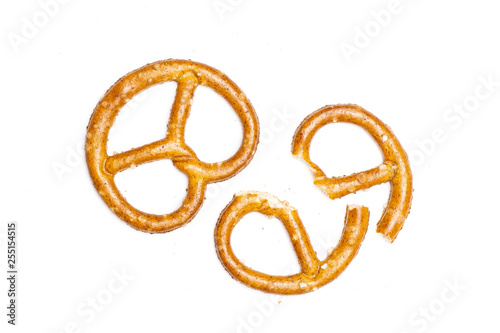 Fototapeta Group of one whole two halves of mini salted pretzels flatlay isolated on white
