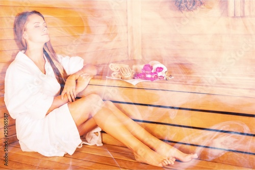 Fotografía Young woman relaxing in bathhouse