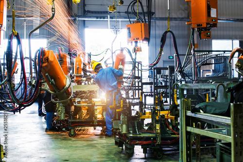 Tablou Canvas Welding robots movement in a car factory