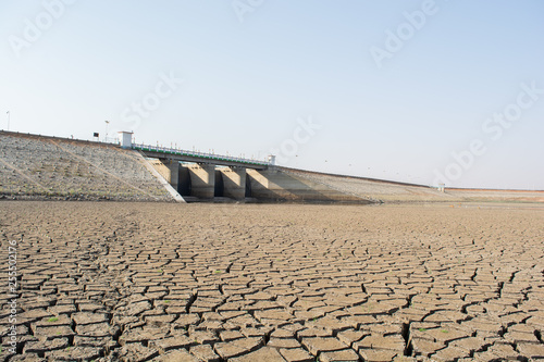 Canvas Print A dried up empty reservoir or dam during a summer heatwave, low rainfall and dro