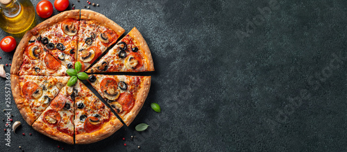 Fotografie, Obraz Tasty pepperoni pizza with mushrooms and olives.