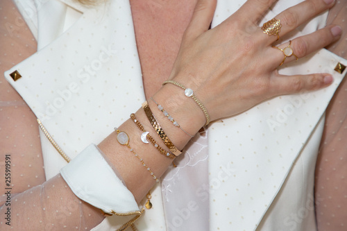 Fotomural Close up Detail of many several bracelet on a Female Hand Model