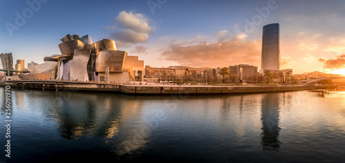 Stampa su Tela Bilbao waterfront during sunset Basque Country Spain aerial view