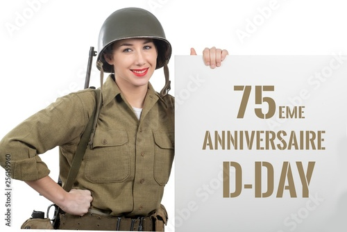 Vászonkép young woman dressed in us  wwii military uniform with helmet sho