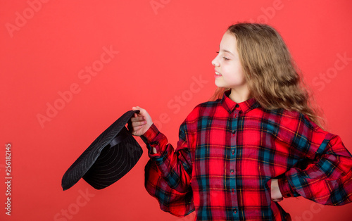 Stampa su Tela Girl artistic kid practicing acting skills with black hat