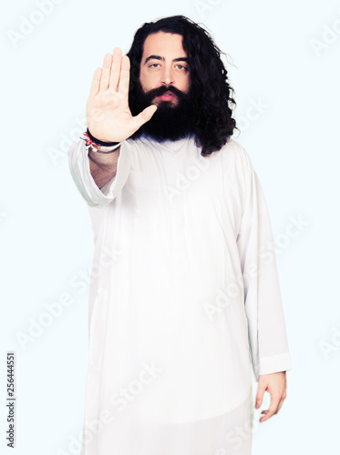 Obraz na plátne Man wearing Jesus Christ costume doing stop sing with palm of the hand