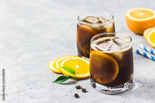 Carta da parati Orange spiced cold brew coffee. Selective focus, space for text.