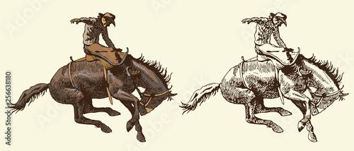 Fotografia Print cowboy riding a wild horse mustang rounding a kicking horse on a rodeo gra