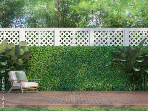 Fotografia Outdoor wood terrace in the garden 3d render,  There is a wooden floor terrace,white fence,furnished with wood and white fabric furniture
