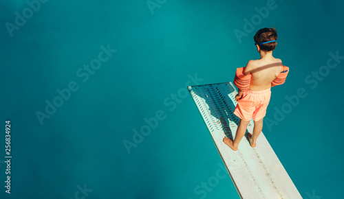 Stampa su Tela Boy standing on a diving board
