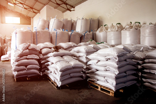 Photo Abstract agrarian image with bags of grain in the agricultural sector in the farm