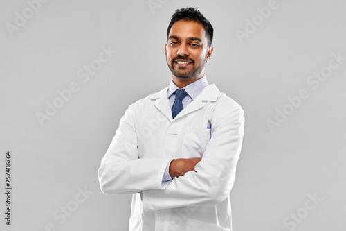 Obraz na plátně medicine, science and profession concept - smiling indian male doctor or scienti