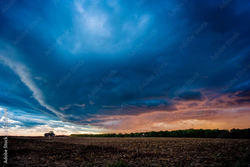 Dramatic sky over field, Marshfield, Wisconsin, USA