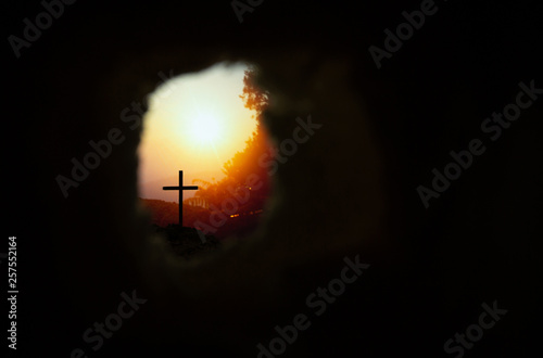 Empty tomb with cross symbol for Jesus Christ is risen Fototapeta