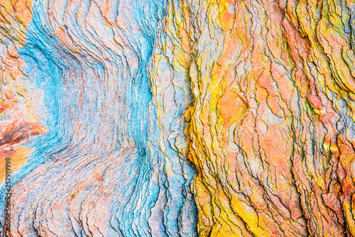 Fotografie, Obraz Colourful sedimentary rocks formed by the accumulation of sediments – natural ro