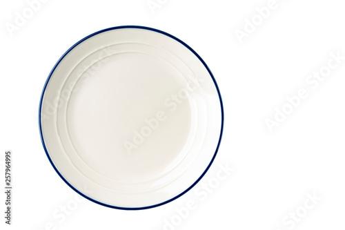 Fototapeta White plate with a blue stripe on the edge.