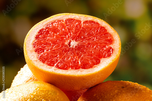 Tablou Canvas Freshly red grapefruit on wooden background