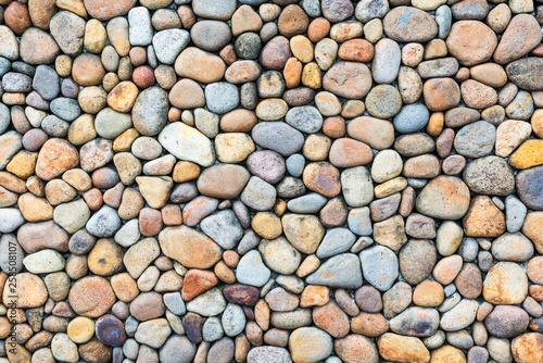 Fotografia Colorful pebble stone wall texture