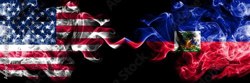 Fototapeta United States of America vs Haiti, Haitian smoky mystic flags placed side by side