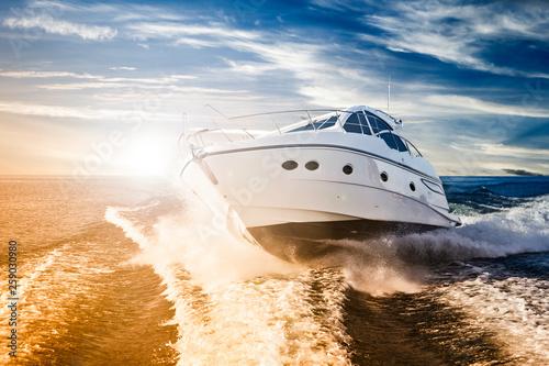 Fotografering Luxurious motor boat sailing the sea at dawn