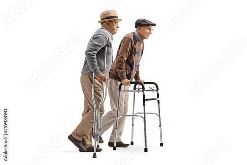 Two elderly men walking with crutches and walker Tapéta, Fotótapéta