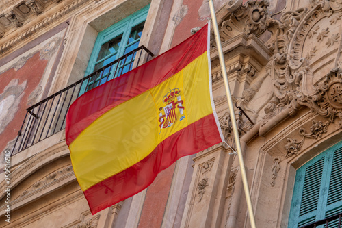 Wallpaper Mural Waving spanish flag on building
