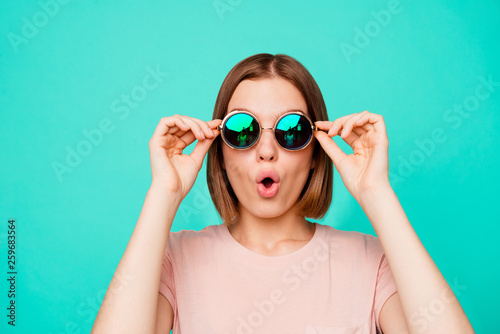 Close up photo beautiful funny funky her she lady hold hands arms dark sunglass look flying airplane first time wonderful sight wear casual pastel t-shirt clothes isolated teal turquoise background #259683564
