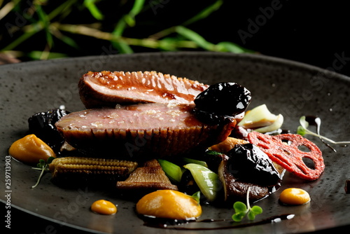 Canvas Print Haute cuisine/Asian fusion, roasted duck with plums and shiitake mushrooms
