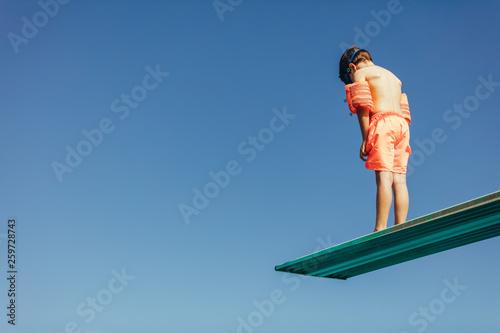 Fotografie, Tablou Boy learning on diving spring board