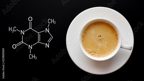 Fotografija Cup of fresh coffee on a black background