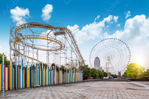 Canvas Roller coasters and ferris wheels in amusement parks。