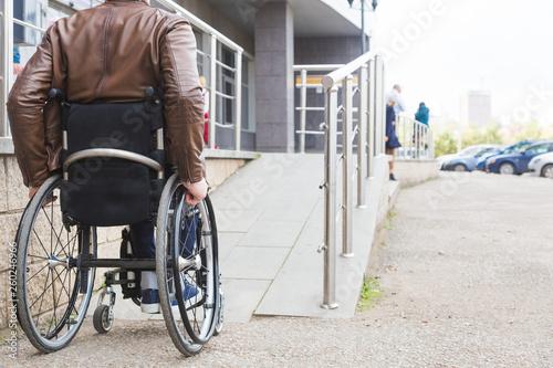 Wallpaper Mural Man in a wheelchair use a wheelchair ramp.