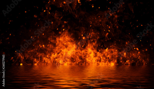 Photo Blaze fire flame texture on isolated background with water reflection