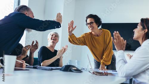 Team of professionals celebrating success