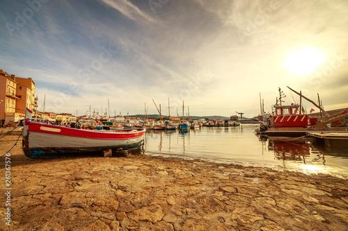 Obraz na plátně Boats and luxury yachts in por of Saint Tropez, France