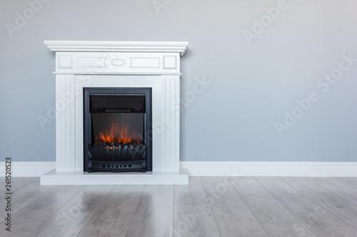 Carta da parati White wooden decorative electric fireplace with a beautiful burning flame