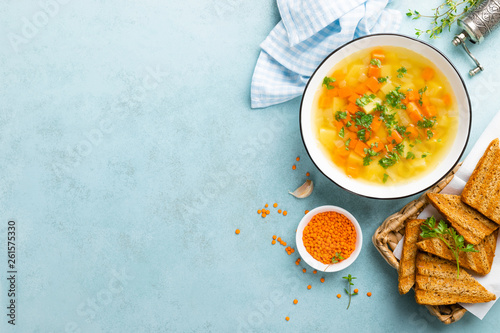 Canvas Print Lentil soup with vegetables and fresh parsley on plate