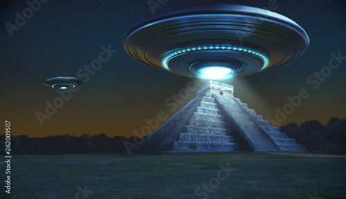 Canvas Print Flying saucer on Maya pyramid ruins Chichen itza in the early night with a light