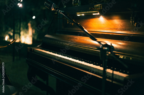 Canvas wooden piano and microphone