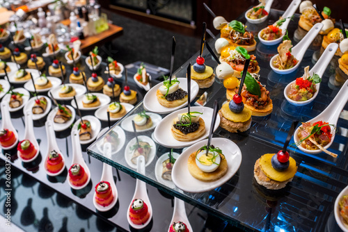 Cuadros en Lienzo buffet table with cold appetizers and aperitifs with fish and caviar