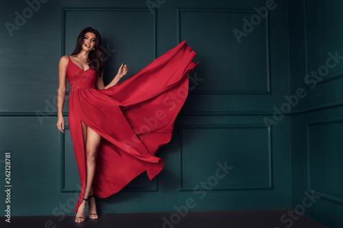 Fashion lady in red maxi dress. Fototapet