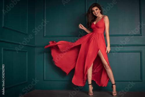 Valokuva Fashion lady in red maxi dress.