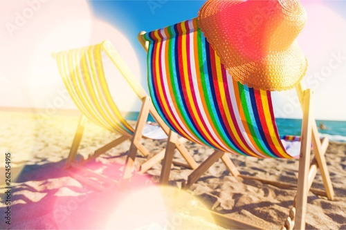 Fotografiet Matcheswooden chaise longue chairs on beach
