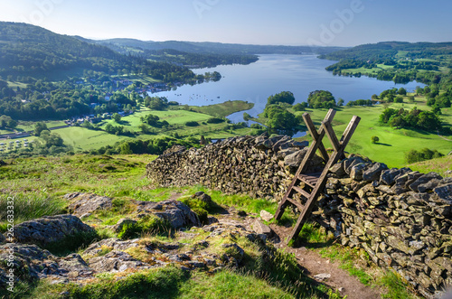 Obraz na plátně A morning shot of Lake Windermere showing the stone walling and the stile providing passage over the wall