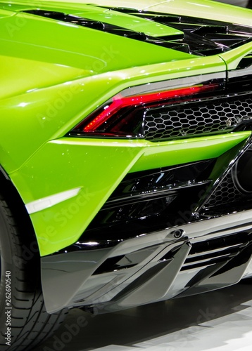 Green shiny modern sports car body tail light and carbon fiber components фототапет