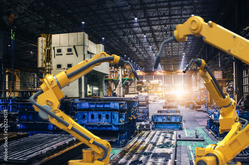 Fotografie, Tablou heavy automation robot arm machine in smart factory industrial,Industry 4