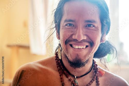 Obraz na plátně Closeup of native american man with beautiful jewelry