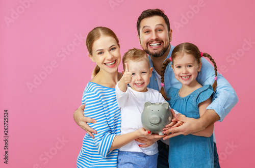 Tela financial planning happy family mother father and children with piggy Bank on pink